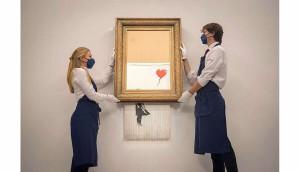 Un tablou al lui Banksy pe jumătate distrus - Vândut cu 22 milioane de euro
